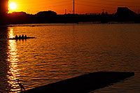 /images/133/2008-10-29-tempe-heron-41448.jpg - #05999: Scullers and Great Blue Heron at North Bank Boat Ramp at sunset at Tempe Town Lake … October 2008 -- Tempe Town Lake, Tempe, Arizona