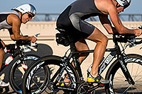 /images/133/2009-09-27-nathan-tri-cycle-114185.jpg - #07465: 01:38:28 - #1145 and #1388 cycling at Nathan Triathlon … September 2009 -- Tempe Town Lake, Tempe, Arizona