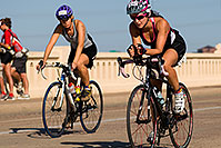 /images/133/2009-09-27-nathan-tri-cycle-114470.jpg - #07477: 01:55:22 - #945 and #1047 cycling at Nathan Triathlon … September 2009 -- Tempe Town Lake, Tempe, Arizona