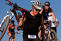 /images/133/2009-10-11-pbr-off-tri-bike-115551.jpg - 07551: 01:03:39 mountain bikers dismounting or not at a steep downhill - PBR Offroad Triathlon, Oct 11, 2009 … October 2009 -- Papago Park, Tempe, Arizona