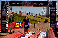 /images/133/2009-10-11-pbr-off-tri-run-115891.jpg - #07564: 02:54:42 Runner finishing on a water slide - PBR Offroad Triathlon, Oct 11, 2009 at Tempe Town Lake … October 2009 -- Tempe Town Lake, Tempe, Arizona