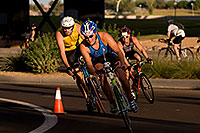 /images/133/2009-10-25-soma-bike-118287.jpg - #07619: 01:06:10 #414 leading #602 cycling at Soma Triathlon … October 25, 2009 -- Rio Salado Parkway, Tempe, Arizona