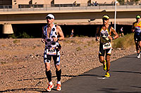 /images/133/2009-11-22-ironman-run-126709.jpg - #07924: 07:09:43 #1143 and #1667 running - Ironman Arizona 2009 … November 2009 -- Tempe Town Lake, Tempe, Arizona