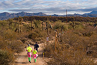 /images/133/2009-12-13-muddy-buddy-129510.jpg - #07991: Couple in skirts at Muddy Buddy Race 2009 … Dec 13, 2009 -- McDowell Mountain Park, Fountain Hills, Arizona