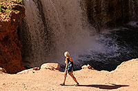/images/133/2010-06-21-havasu-people-6903.jpg - #08194: Hiker walking by Rock Falls … June 2010 -- Rock Falls, Havasu Falls, Arizona