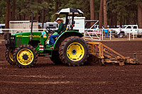 /images/133/2010-07-10-flag-naha-tractor-12458.jpg - #08222: Preparing the field for NAHA event in Flagstaff … July 2010 -- Fort Tuthill County Park, Flagstaff, Arizona