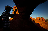 /images/133/2010-09-05-arches-delicate-wind-31693.jpg - #08594: Photographer silhouette and view of Delicate Arch in Arches National Park … September 2010 -- Delicate Arch, Arches Park, Utah