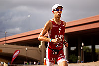 /images/133/2010-11-21-ironman-run-pros-45828.jpg - #08965: 04:54:13 - #1 Jordan Rapp holding second place on Lap 2 - Ironman Arizona 2010 … November 2010 -- Tempe Town Lake, Tempe, Arizona