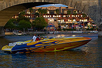 /images/133/2011-04-02-havasu-bridge-evening-65783.jpg - #09120: Boat at London Bridge in Lake Havasu City … April 2011 -- London Bridge, Lake Havasu City, Arizona
