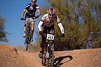 /images/133/2012-01-07-papago-bikes-jumps-135004.jpg - #09922: 04:21:27 #62 jumping behind #213 at 12 Hours of Papago 2012 … January 7, 2012 -- Papago Park, Tempe, Arizona