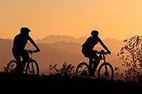 /images/133/2012-01-07-papago-bikes-sunset-136605.jpg - #09946: 10:08:09 #411 and #241 mountain biking at sunset at 12 Hours of Papago 2012 … January 7, 2012 -- Papago Park, Tempe, Arizona