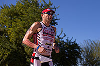 /images/133/2014-11-16-ironman-run-1dx_3885.jpg - #12251: 06:03:17 #42 Patrick Schuster [25th,USA,09:45:46] running at Ironman Arizona 2014 … November 2014 -- Tempe Town Lake, Tempe, Arizona