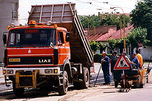 red Liaz construction truck and workers in Kosice