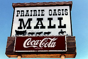 Prairie Oasis Mall - Cowboy and cows wagon picture - Coca Cola sign … Christina moving Chicago-Phoenix