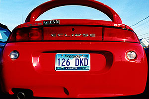 red Mitsubishi Eclipse GS … hunting for my Jeep Cherokee in Lousville, Kentucky