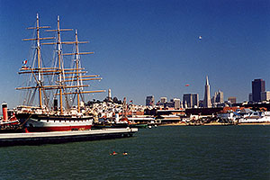 Ship docked in San Francisco harbor … people swimming in the Bay … Seagull and Zeppelin in the air