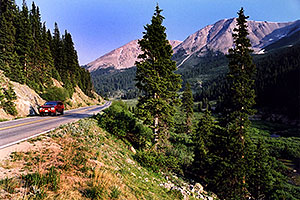 red Jeep Grand Cherokee heading to Aspen from Independence Pass