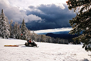 Snowmobiler Ski Patrol at Snowbowl ski area