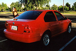 Michelle and her red VW Jetta