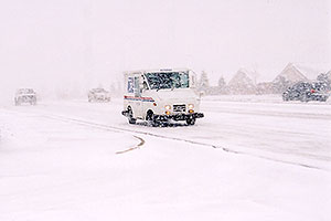US mail truck in November snow, along Yosemite Road in Lone Tree