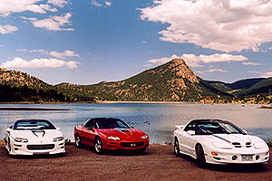 white and red Pontiac TransAm cars at Estes Lake
