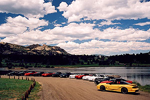 yellow, red, black and white Pontiac TransAm cars at Estes Lake