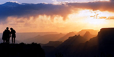Silhouettes of Aneta, Ewka and Ola (left to right) at sunset in Grand Canyon