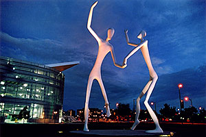 Denver Figures at twilight (by Performing Arts Center)