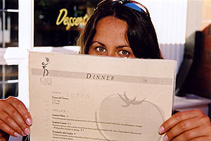 Ola with menu at Café Colore in Denver