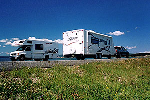 motorhomes with Yellowstone Lake in the background