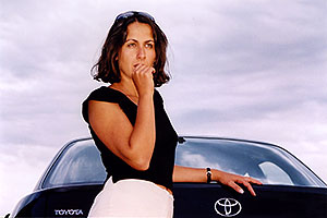Ola by her black Toyota Camry in Englewood