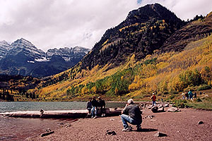 People at Maroon Lake with Maroon Peaks in the background