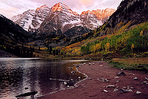 7am sun touches the peaks of Maroon Bells
