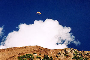 Orange Paraglider over Cinnamon Mountain (12,293ft)