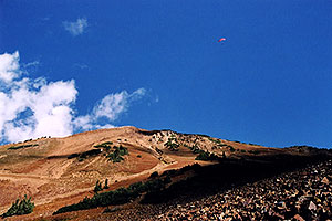 Red Paraglider west of Cinnamon Mountain