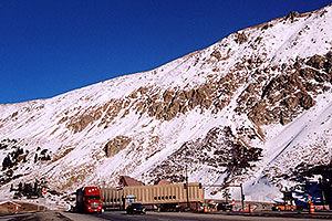 red semi truck leaving Eisenhower Tunnel (elev 11,013ft) and heading to Silverthorne