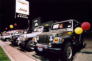 brown, white and blue Jeep Wranglers at Lithia Jeep in Centennial, Colorado