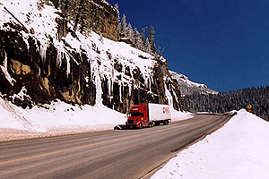 red Semi Truck going down Wolf Creek Pass towards Durango