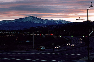 sunset above Pikes Peak … cars approaching I-25 from west on Woodmen Road