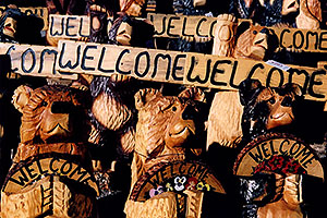Carved Bear statues with Welcome signs