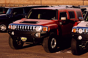 morning frost on a red 2006 H3 Hummer in Castle Rock