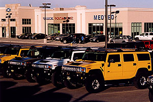 yellow, white and grey 2006 H2 Hummers in Castle Rock