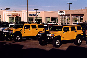yellow H3 (front)  and yellow H2 Hummers in Castle Rock