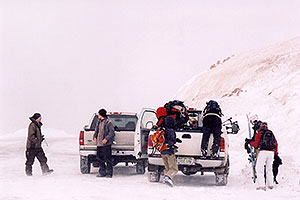 Backcountry Skiers and Snowboarders unloading at top of Loveland Pass