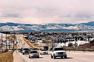 Cars in Highlands Ranch with western mountains in the background