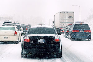 black Audi A4 and cars, during blizzard on Highway I-70 west of Golden