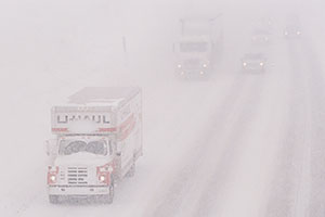 U-Haul and cars, during blizzard on Highway I-70 west of Golden, heading to Denver