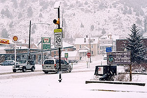 white Jeep Wrangler on a snowy midday … images of Idaho Springs
