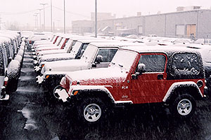 red Jeep Wrangler X and other snowy Jeep Wranglers at Lithia Jeep