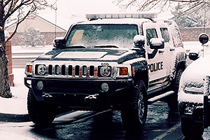 snowy Police Hummers in Lone Tree
